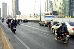 BTS (Skytrain) and traffic on a bridge over teh Chao Praya River