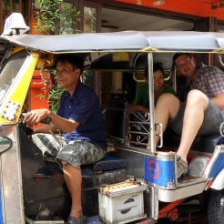 Elegantly squeezing into a tuk-tuk