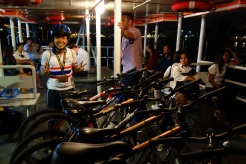 Our bike tour guide Game, on a ferry across the Chao Praya River