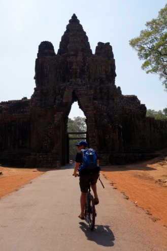 Riding through the Eastern Gate of Angkor Thom