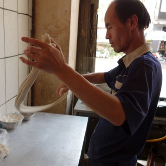 Hand-pulled noodles in action