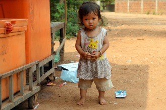 Scared litle girl near sugar cane juice stand