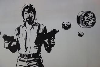 Chuck Norris shooting Dim Sum out of guns