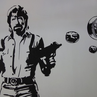 Chuck Norris shooting Dim Sum out of guns