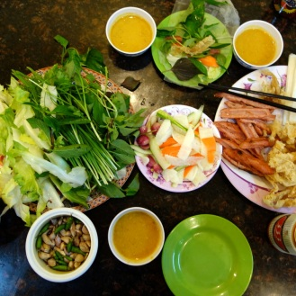 Kick-ass dinner of Nem Nuong. DIY spring rolls with minced pork and shrimp on sugar cane, loads of fresh herbs, deep fried race paper, pickled carrots, radish and shallots, all dipped in a fantastic peanut-tumeric sauce.