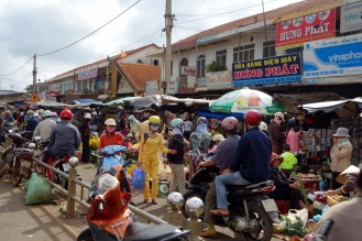 Town market on the road. Sweet all-yellow outfit.