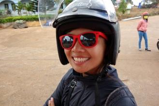 Rocking the motorcycle helmet.