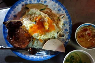 Broken rice with pork chop and fried egg.