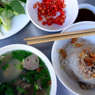 Deconstructed pho for breakfast in Pleiku with the noodles and broth served separately. (called pho kho)
