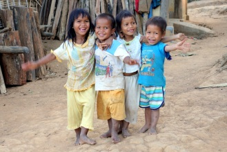 Cute kids running out to shout hello, visiting a minority village outside Kon Tum