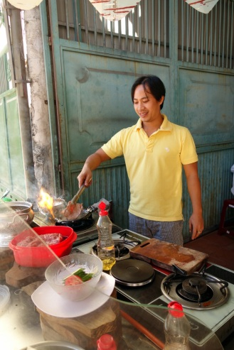 Lan's friend cooking us up our best breakfast of the trip so far.