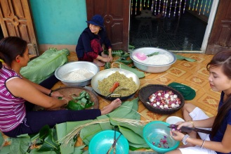 We stopped at another hill tribe visit. After sitting with a group of young men and drinking rice wine (at about 9am) and eating barbecued dog meat, we watched these women prepare special cakes for Tet.