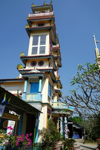 Stop at cao dai temple on the road to Hoi An.