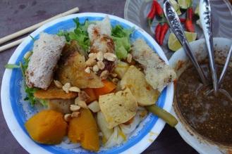 Fantastic veggie noodle soup with pumpkin, taro pancake, spring rolls, etc.
