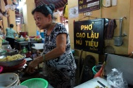 Eating the Hoi An specialty cao lau in the market.