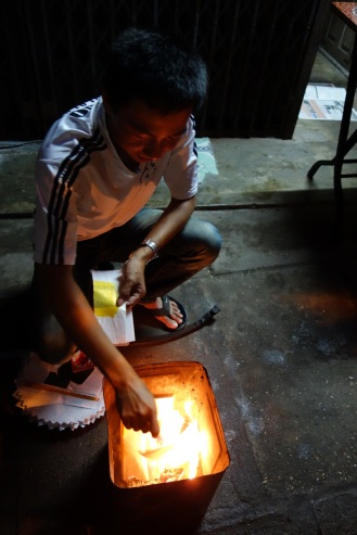 Burning fake money after midnight
