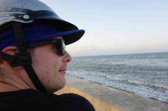 Beach motorcycle with awesome helmet.