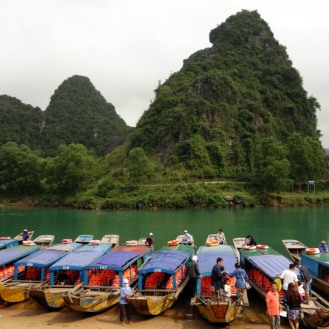 Boats lined up to bring tourists into Phong Nha Cave