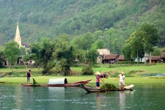 Locals harvesting riverweed
