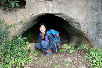 Small cave on the road. A site wehre 50 vietnames women would hide during the war, waiting to clear away rubble on the roadways from US mombings. The bombs would target the limestone cliffs to try to cover up the nearby roadways and breaking supply lines.