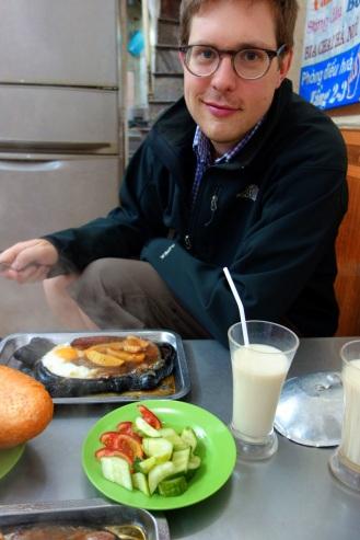 Enjoying with a glass of fresh soy milk.