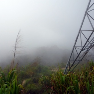 Fog rolling in beside the hydro tower. A couple minutes before there was a beautiful view of the town down below.On the