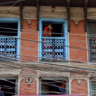 We wandered across a parade or festival of some sort. This girl was watching from her window.