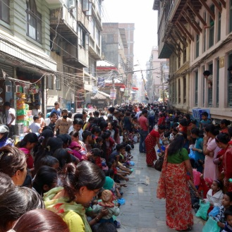 Line of kids waiting to give offerings