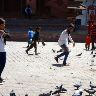 Playing with pigeons in the square