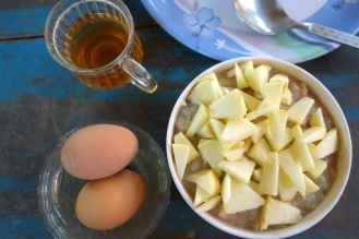 Porridge with apples, boiled eggs and tea. Our typical breakfast.