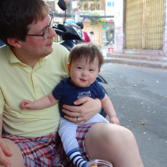 Enjoying our Banh Mi Op La street-side