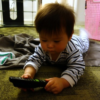 He loves his remote controls...