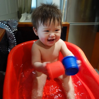 Having fun in his new bathtub (after we dicovered that he hates taking showers)