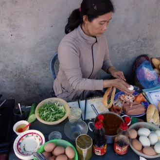 One banh mi lady at her craft