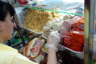 the most epic meat banh mi being made