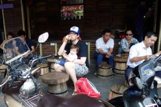 Jesse enjoying his ca phe den (black coffee with ice)