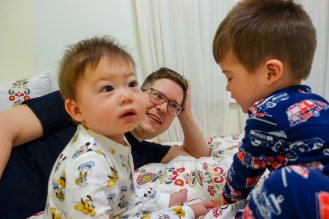 The boys playing in bed