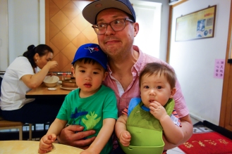 Gong show of a dinner in Dongmen. Both kids were going nuts.