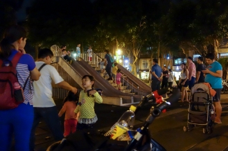 Busy concrete slide park in Dongmen