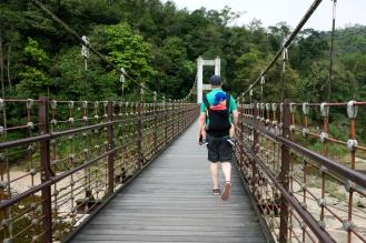Jesse and Daneil crossing a suspension bridge
