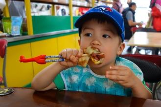 Daniel still perfecting his chopstick skills
